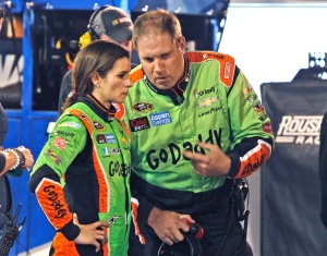 Danica Patrick, left, talks with her crew in the garage after a crash the NASCAR Sprint Cup Series auto race at Martinsville Speedway in Martinsville, Va., Sunday, Nov. 1, 2015. (AP / Steve Helber)