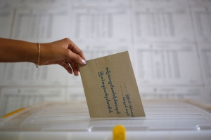A voter casts a ballot in advance for the upcoming Nov. 8 general election at a township Election Commission Office in Mandalay, Myanmar, Saturday, Nov. 7, 2015. (AP / Hkun Lat)
