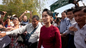 Myanmar opposition leader Aung San Suu Kyi leaves after voting at a polling station at Kaw Hmu township during the general election Sunday, Nov 8, 2015, in Yangon, Myanmar. (AP / Khin Maung Win)