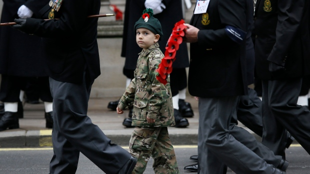 A young boy marches with veterans down Whitehall at the Remembrance Sunday ceremony at the Cenotaph in London, Sunday, Nov. 8, 2015. (AP / Kirsty Wigglesworth)
