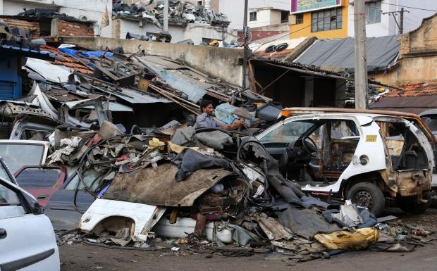 Indian worker dismantles old car