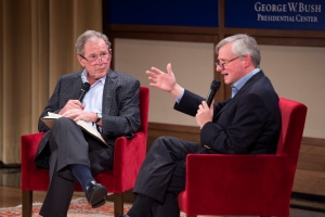 Former U.S. President George W. Bush, left, listens to Pulitzer Prize winning author Jon Meacham, right, talk about his biography of Bush's father, former President George H. W. Bush at the George W. Bush Presidential Center in Dallas on Sunday, Nov. 8, 2015. (AP / Jeffrey McWhorter)