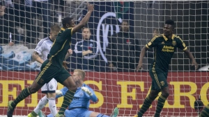 Portland Timbers FC Fanendo Adi celebrates his goal past Vancouver Whitecaps goalkeeper David Ousted during the first half of MLS soccer action in Vancouver, B.C. on Sunday, Nov. 8, 2015. (Jonathan Hayward / THE CANADIAN PRESS)