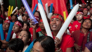 Supporters of Myanmar opposition leader Aung San Suu Kyi's National League for Democracy party cheer as they watch the results of the general election on an LED screen displayed outside the party's headquarters in Yangon, Myanmar on Monday, Nov. 9 2015. (AP / Khin Maung Win)