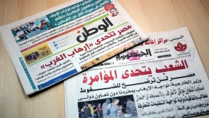Two Egyptian daily newspapers with headlines touting Western conspiracy theories in the Metrojet crash, on Nov. 8, 2015. (AP)