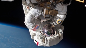 In this Saturday, May 11, 2013 photo made available by NASA, astronaut Chris Cassidy performs a space walk to inspect and replace a pump controller box on the International Space Station.  (AP/NASA)
