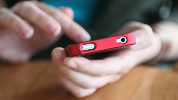 A person uses their smartphone in this file photo. (D. Hammonds/shutterstock.com)