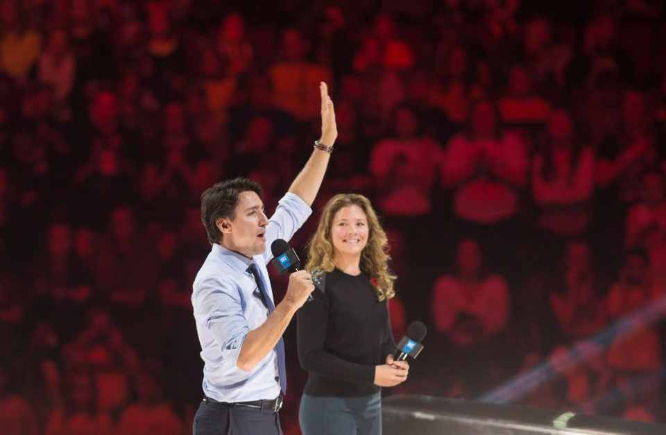 Prime Minister Justin Trudeau and his wife Sophie Gregoire-Trudeau appear at the WE Day celebrations in Ottawa, Tuesday November 10, 2015. (THE CANADIAN PRESS / Adrian Wyld)