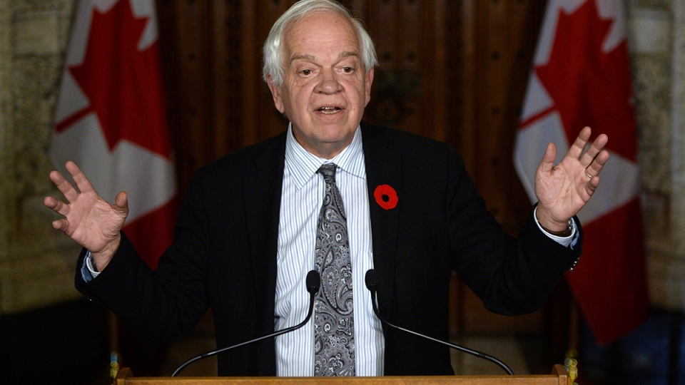 Minister of Immigration, Refugees and Citizenship John McCallum speaks to reporters in the foyer of the House of Commons on Parliament Hill in Ottawa on Monday, Nov.  9, 2015. (Sean Kilpatrick / THE CANADIAN PRESS)