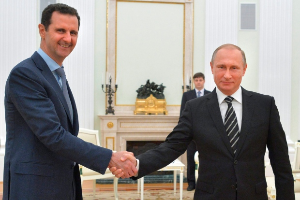 Putin and Assad shake hands