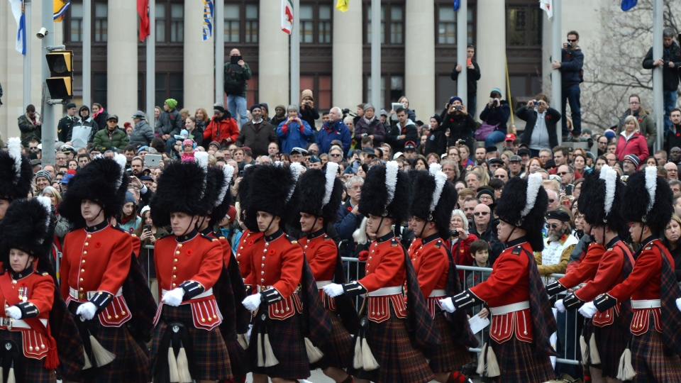 Spectators watch as members of the Cameron Highlanders march as part of the Remembrance Day ceremony in Ottawa on Wednesday, Nov. 11, 2015. (Sean Kilpatrick / THE CANADIAN PRESS)