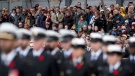 Members of the public look on during the Remembrance Day ceremony at the National War Memorial in Ottawa on Wednesday, Nov. 11, 2015. (Justin Tang/The Canadian Press)