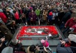 People place poppies on the Tomb of the Unknown Soldier at the National War Memorial following the Remembrance Day ceremony in Ottawa on Wednesday, Nov. 11, 2015. (Justin Tang / THE CANADIAN PRESS)