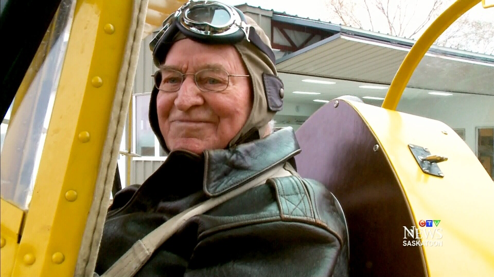 Reg 'Crash' Harrison in a Tiger Moth