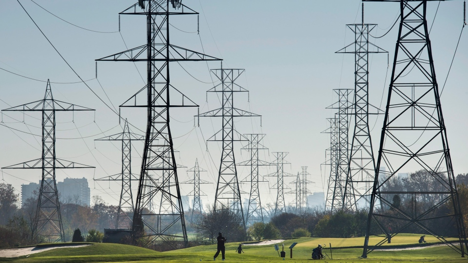 Hydro towers are seen over a golf course in Toronto on Wednesday, Nov. 4, 2015. (The Canadian Press/Darren Calabrese)