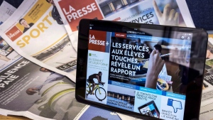 La Presse is seen on tablet and in print, on Wednesday, Sept. 16, 2015. (THE CANADIAN PRESS/Paul Chiasson)