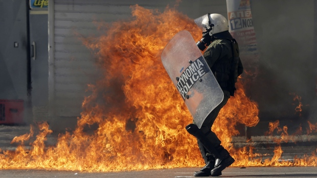 A riot policeman tries to avoid a petrol bomb thrown by protesters during a rally in Athens, Thursday, Nov. 12, 2015. (AP / Thanassis Stavrakis)