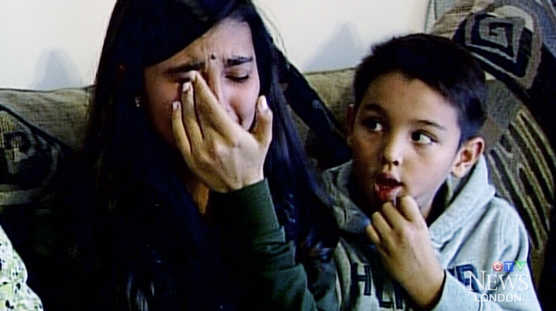 The Regalado children, Laura, 13, and Juan, eight, speak at their home in London, Ont.