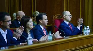 Ukraine's Prime Minister Arseniy Yatsenyuk, right, applauds after parliament voted for the sexual minorities anti-discrimination bill in the parliament session hall in Kyiv, Ukraine, Thursday, Nov. 12, 2015. (AP / Andrew Kravchenko)
