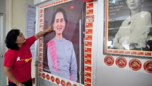 A member of the Myanmar National League for Democracy party cleans a portrait of party leader Aung San Suu Kyi at the headquarters, in Yangon, Burma, Friday, Nov. 13, 2015. (AP / Khin Maung Win)
