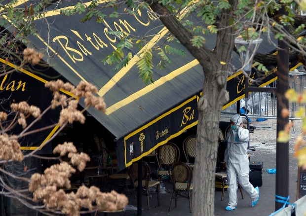 An investigator works outside the Bataclan concert hall, Saturday, Nov. 14, 2015 in Paris. (Christophe Ena / AP Photo)