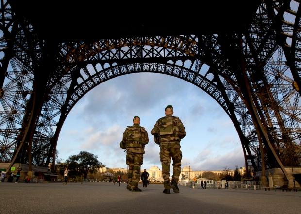 Soldiers patrol Eiffel Tower