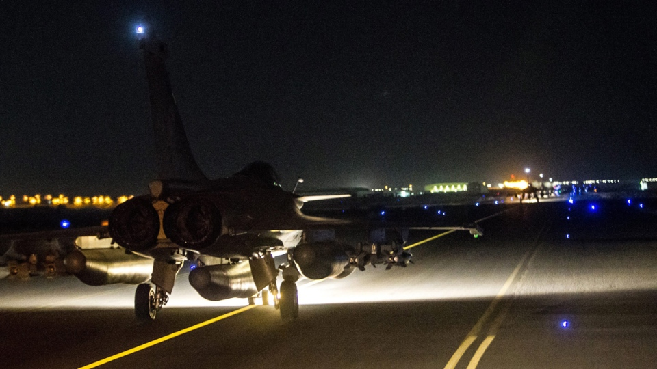 French army jet on the tarmac of an undisclosed air base as part of France's Operation Chammal, on Nov. 15, 2015. (French Air Force / ECPAD via AP)