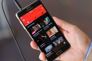 This photo shows the YouTube Music app on a mobile phone on Friday, Nov. 13, 2015, in Los Angeles. (AP Photo/Richard Vogel)