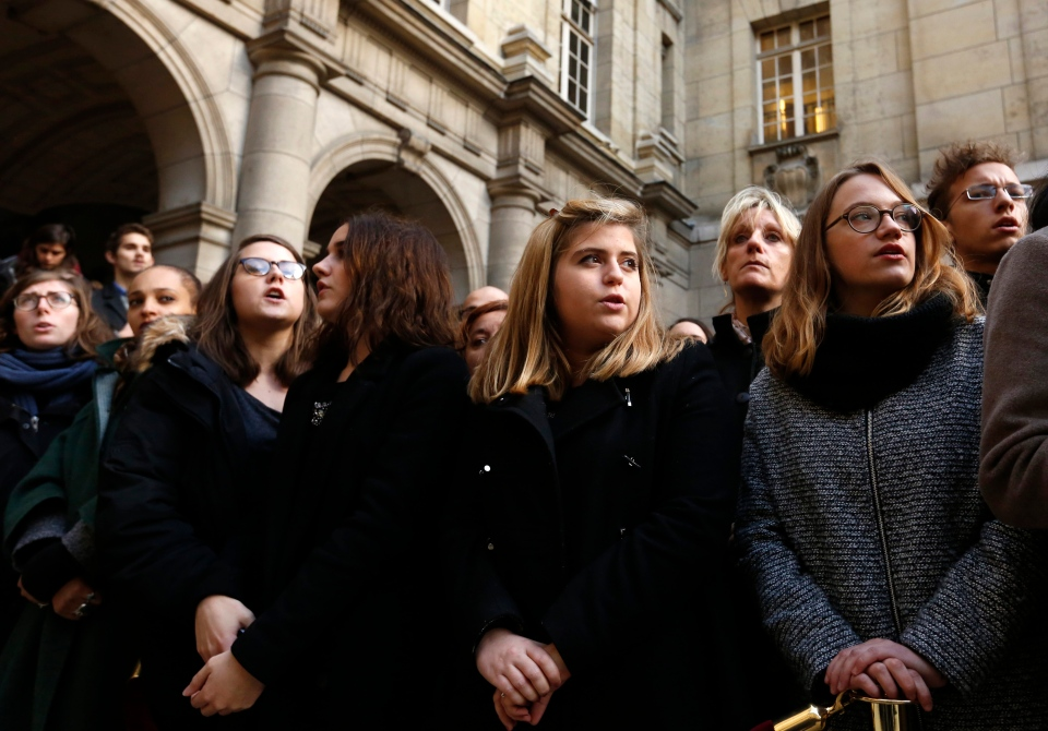 Students sing the national anthem after observing a minute of silence in the courtyard of the Sorbonne University in Paris, Monday, Nov. 16 2015. (Guillaume Horcajuelo)