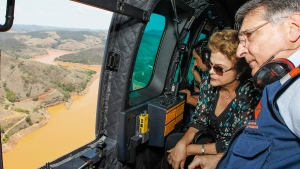 Brazilian President Dilma Rousseff accompanied by Minas Gerais state Gov. Fernando Pimentel, looks out over the area of dam bursts at an iron ore mine, in Minas Gerais, Brazil, on Nov. 12, 2015. (Roberto Stuckert Filho / Brazil Presidential Press Office via AP)