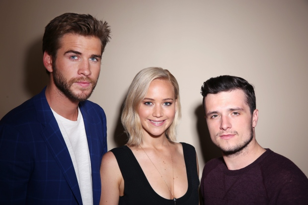 In this Saturday, Oct. 31, 2015 photo, actors Liam Hemsworth, from left, Jennifer Lawrence and Josh Hutcherson, from 'The Hunger Games: Mockingjay - Part 2,' pose for a portrait in Los Angeles. (Matt Sayles/Invision/AP)