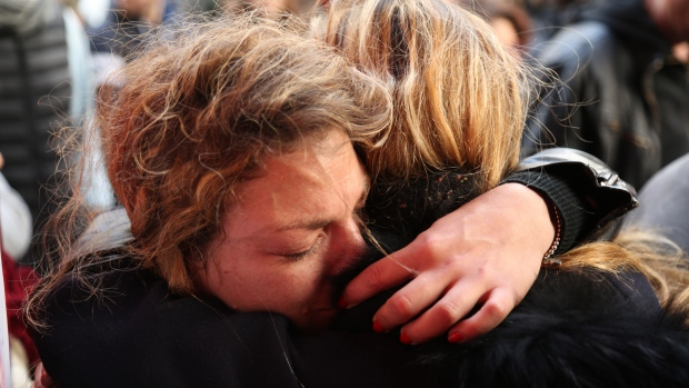 Women embrace at vigil outside La Belle Equipe in Paris on Monday, Nov. 16, 2015. Nineteen people were killed at the café during terrorist attacks. (John Mees / CTV News).