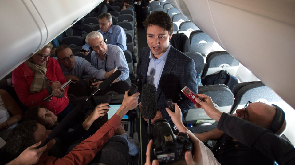 Prime Minister Justin Trudeau speaks to reporters while flying from Antalya, Turkey to Manila, Philippines on Tuesday, Nov. 17, 2015, to attend the APEC Summit. (Sean Kilpatrick / THE CANADIAN PRESS)