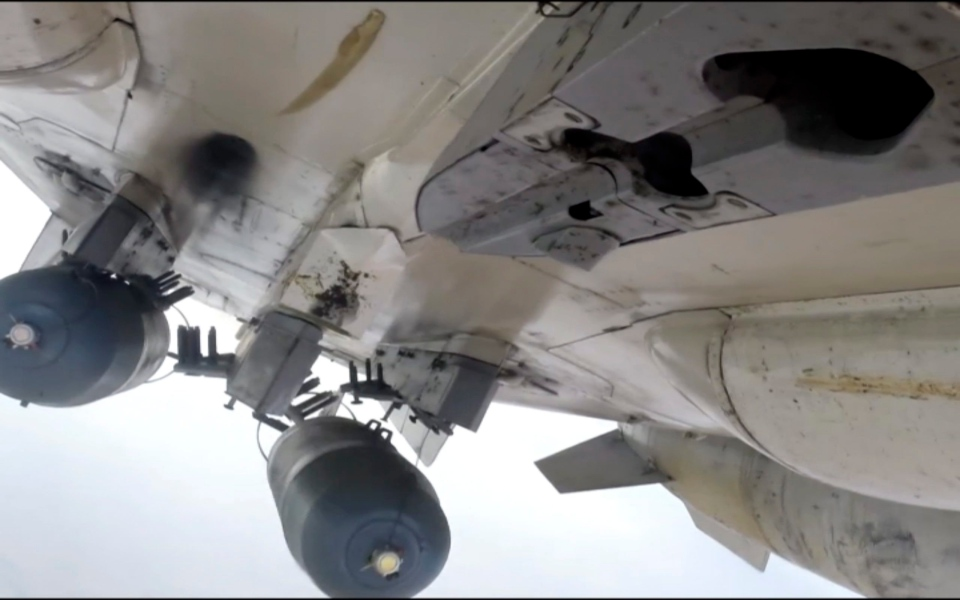 This photo made from footage taken from Russian Defense Ministry official website Tuesday, Nov. 17, 2015, shows a Russian Su-24M during a Russian air raid in Syria. (Russian Defense Ministry Press Service via AP)