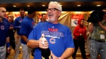 In this Oct. 7, 2015, file photo, Chicago Cubs manager Joe Maddon waits for pitcher Jake Arrieta to arrive in the locker room to begin celebrating a 4-0 win over the Pittsburgh Pirates in the National League wild card baseball game in Pittsburgh. (Gene J. Puskar / AP Phot)