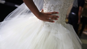 A woman wears a dress at the Grand Oriental Wedding Show, in Paris, on Saturday, Oct. 31, 2015. (AP Photo/Thibault Camus)