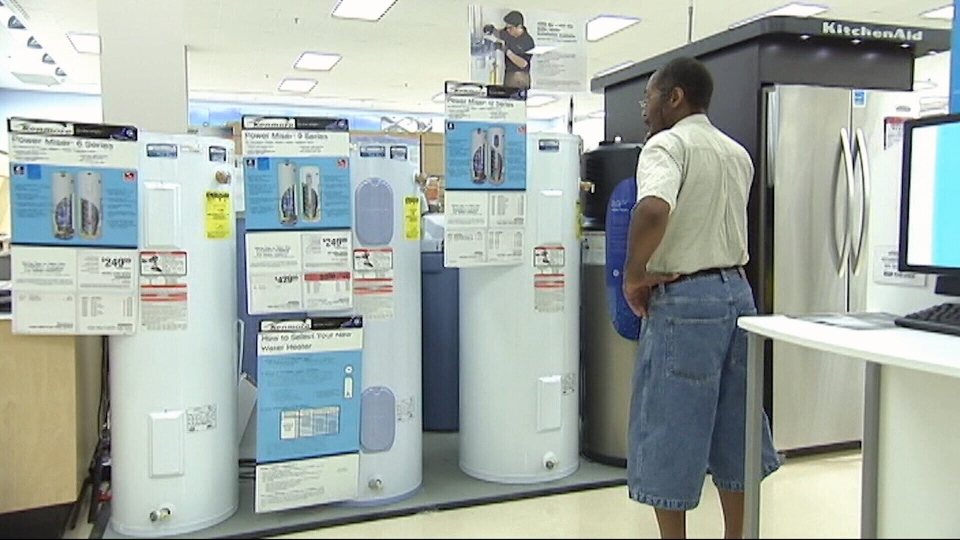 Man looking at water heaters