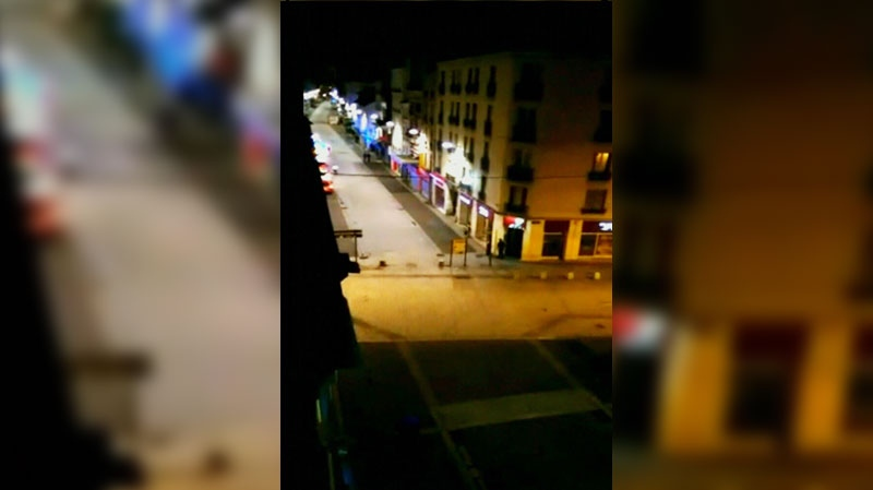 Benson Hoi filmed this image of a raid on a terrorist cell in the Paris suburb of Saint-Denis, on Wednesday, Nov. 18, 2015.
