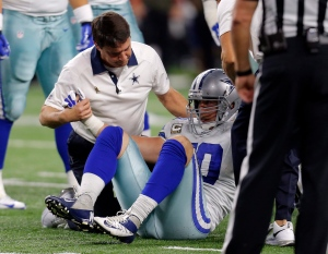 In this Nov. 8, 2015, file photo, Dallas Cowboys' Sean Lee is assisted by team staff after suffering an injury in the second half of an NFL football game against the Philadelphia Eagles, in Arlington, Texas.  (AP/Brandon Wade, File)