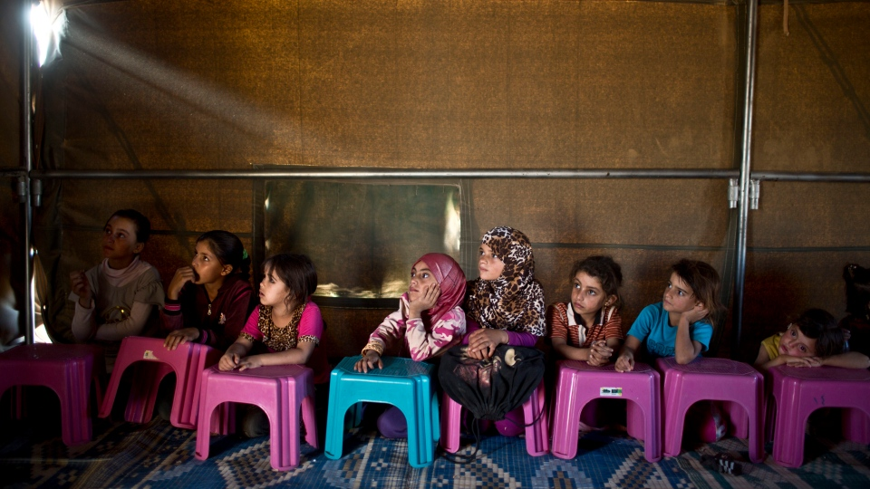 Syrian refugee children attend a class at a makeshift school near Mafraq, Jordan, on Wednesday, Oct. 21, 2015. AP Photo/Muhammed Muheisen)
