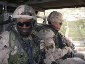 Harjit Sajjan in a helicopter (Courtesy of Maj. Gen. (ret) David Fraser)
