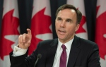 Finance Minister Bill Morneau speaks to media as he delivers a fiscal update during a news conference, in Ottawa, on Friday, Nov. 20, 2015. (Adrian Wyld / THE CANADIAN PRESS)