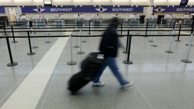 A passenger is seen walking through Chicago's Midway International Airport on Tuesday, Feb. 9, 2010. (AP / M. Spencer Green)