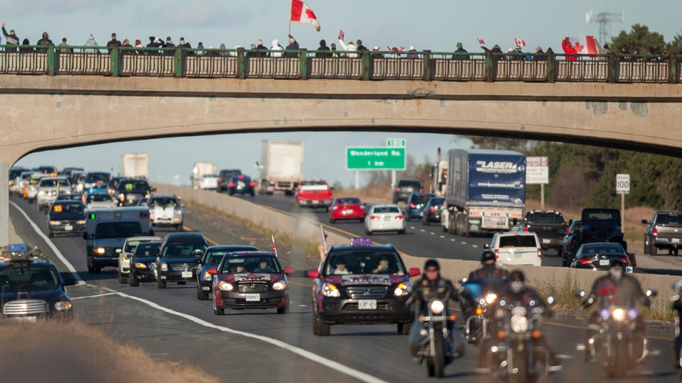 The procession for former Canadian soldier John Gallagher, who was killed while fighting against ISIS in Syria passes by London, Ont., Friday, Nov. 20, 2015. (Geoff Robins / THE CANADIAN PRESS)