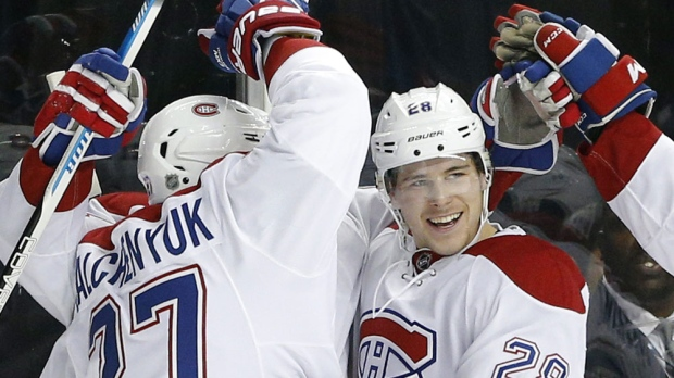 Montreal Canadiens defenceman Nathan Beaulieu (28) celebrates scoring a goal during the first period of an NHL hockey game against the New York Islanders on Friday, Nov. 20, 2015, in New York. (AP Photo/Paul Bereswill)