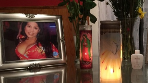 An altar made by the friends of Tamara Dominguez during a memorial service for her at her home on Monday, Aug. 17, 2015. (Randall Jenson/Kansas City Anti-Violence Project via AP)