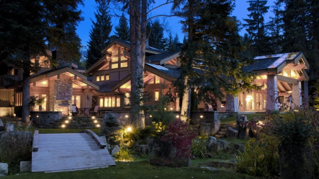 Located on the banks of a private lagoon near Alta Lake, this Whistler, B.C. luxury home is set behind gates on park-like acreage. Just minutes away from world-class skill hills, this seven-bedroom, eight-bathroom home features glass walls, a waterfall, and a hot tub and sauna. Interested? 6805 Crabapple Drive could be yours for $11,995,000. (Amanda Oster/Thornhill Real Estate Group).