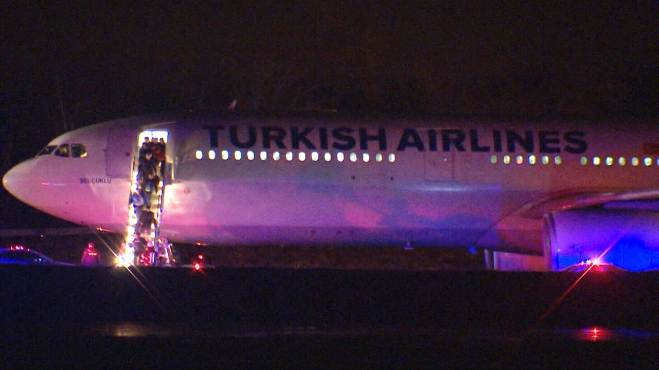 Passengers exit Turkish Airlines flight TK2 after the plane was diverted to Halifax.