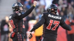 Ottawa Redblacks kicker Chris Milo, left, celebrates kicking a field goal with teammate Thomas DeMarco during second half action in the CFL East Division final in Ottawa, Sunday November 22, 2015. (THE CANADIAN PRESS/Sean Kilpatrick)