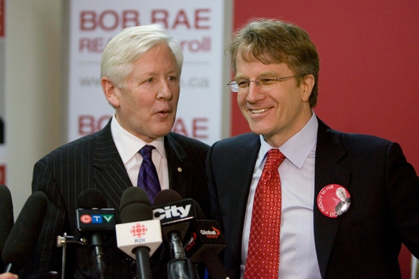 Liberal MP Bob Rae, left, and Gerard Kennedy speak to reporters at Rae's headquarters in Toronto on Monday, Dec. 8 2008. (Chris Young / THE CANADIAN PRESS)